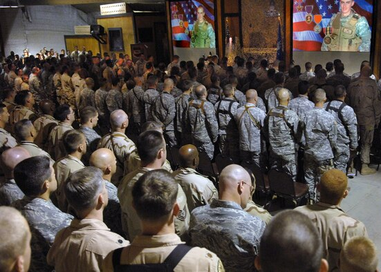 Members of Balad Air Base, Iraq, and Anaconda Base gather for the memorial service for Senior Airman William N. Newman June 10. (U.S. Air Force photo/Tech. Sgt. Alan Port)