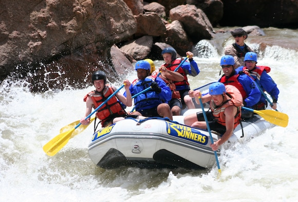 CAÑON CITY, Colo. -- Schriever Airmen take on the white water of Colorado's Arkansas River near Royal Gorge June 2. The rafting adventure was part of an outing sponsored by the 50th Space Wing Chaplain Service Team and offered a core values conditioning session on the importance of commitment. (courtesy photo/50th Space Wing Chaplain Service Team)