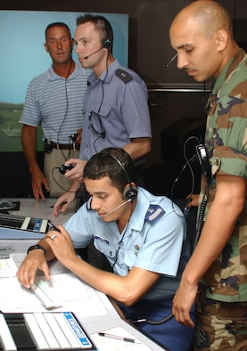 From top left, instructor Steve Harberson, Lieutenants Wadowski and Alamri and Capt. Jason Newcomer, another instructor, train inside the air traffic control tower simulator in Cody Hall.  (U. S. Air Force photo by Kemberly Groue)