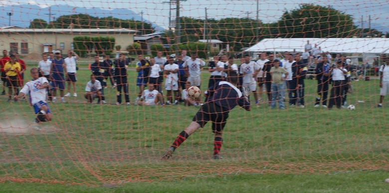 Joint Task Force-Bravo goalie, Bryan Hoover, makes diving save during a shootout between JTF-Bravo and the Honduran Air Force at JTF-B Sports Day June 13. JTF-Bravo sports day pitted athletes from Soto Cano Air Base against their Honduran military counterparts in six events; soccer, swimming, basketball, softball, volleyball and a 4x400-meter relay race. U.S. Air Force photo by Senior Airman Shaun Emery.
