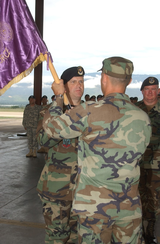 Accepting the Joint Security Forces guidon from Lt. Col. Howard Jones, Joint Task Force-Bravo deputy command,  Maj. John Swift assumes command of JSF at Soto Cano Air Base, Honduras June14.  Major Swift arrived from Scott Air Force Base, Ill., where he served as Training Branch and Force Protection Inspections chief in the Office of the Inspector General, Headquarters Air Mobility Command.  U.S. Air Force photo by Martin Chahin.