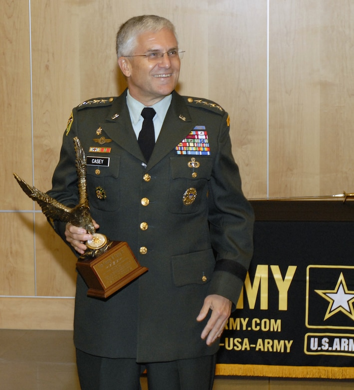 """Gen. George Casey, Army chief of staff, addressed Defense Intelligence Agency personnel June 13 during their 232nd Army birthday celebration on Bolling at the Defense Intelligence Analysis Center. He was presented a token of appreciation by Lt. Gen. Michael Maples, DIA director, for supporting DIA's celebration. The U.S. Army has been serving Americans for 232 years. """"It was humbling to take over an organization that is the best in the world at what it does,"""" said General Casey. """"The Army is as focused and committed today as I have ever seen it."""" (U.S. Air Force photo by Senior Airman Jaclyn McDonald)"""
