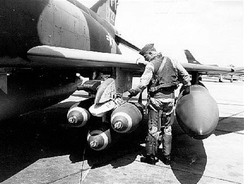 Col. Robin Olds checks munitions on his F-4C Phantom, Scat XXVII, prior to a mission.  He was the commander of the 8th Tactical Fighter Wing at Ubon Air Base, Thailand, and was credited with shooting down four enemy MiG aircraft in aerial combat over North Vietnam.  (U.S. Air Force photo)