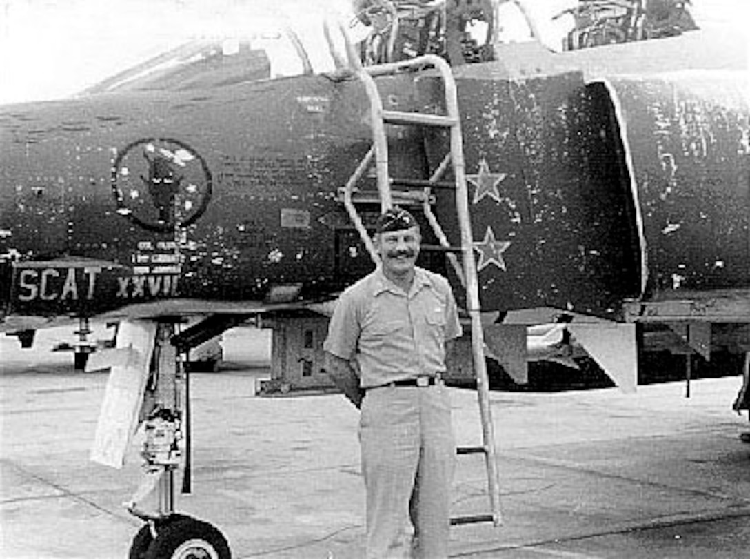 Col. Robin Olds with his F-4C Phantom, Scat XXVII.  He was the commander of the 8th Tactical Fighter Wing at Ubon Air Base, Thailand, and was credited with shooting down four enemy MiG aircraft in aerial combat over North Vietnam.  (U.S. Air Force photo)