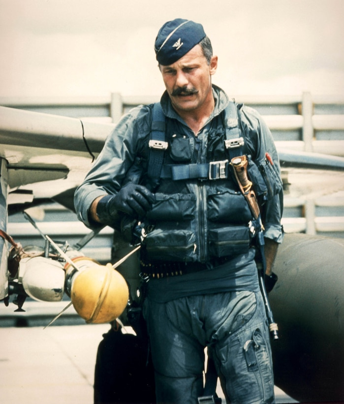 Col. Robin Olds preflights his F-4C Phantom before a mission in Southeast Asia.   He was the commander of the 8th Tactical Fighter Wing at Ubon Air Base, Thailand, and was credited with shooting down four enemy MiG aircraft in aerial combat over North Vietnam.  (U.S. Air Force photo)