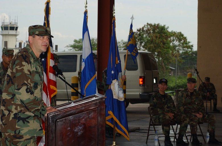 Lt. Col. Randy Vogel adresses his new troops during the Air Force Forces change of command ceremony June 15 here. Colonel Vogel takes command from Lt. Col. Thomas Griesbaum, who served as commander for the past year. The AFFOR mission to to provide air base support, including air traffic control, logistics, base civil engineering, fire department and personnel support. U.S. Air Force photo by Martin Chahin.