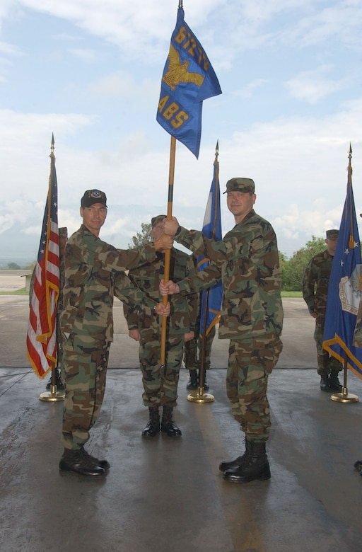 By accepting the 612th Air Base Squadron guidon from Col. Mark Mouw, 474th Operations Group commander, left, Lt. Col. Randy Vogel assumes command of Air Force Forces at Soto Cano Air Base, Honduras June 15. Colonel Vogel was previously the 55th Wing director of staff at Offutt Air Force Base, Neb. U.S. Air Force photo by Martin Chahin.