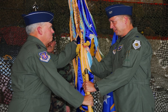 OSAN AIR BASE, Republic of Korea -- Lieutenant General Steven G. Wood, Commander 7th Air Force, passes the 51st Fighter Wing guidon to Colonel Jon Norman as he takes over as Commander of the 51st Fighter Wing during the change of command ceremony today.  (U.S. Air Force photo by Airman 1st Class Chad Strohmeyere)