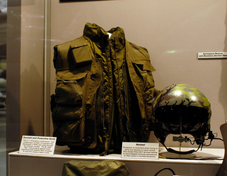 DAYTON, Ohio -- The C-1 emergency sustenance vest, developed by the U.S. Army Air Forces in World War II and used through the Southeast Asia War, was worn over the M-1952 flak vest. To provide protection in harsh terrain and combat situations, PJs wore the camouflaged HGU-26/P aircrew helmet. These items are on display in the Southeast Asia War Gallery at the National Museum of the U.S. Air Force. (U.S. Air Force photo)