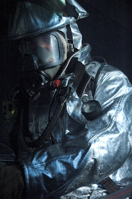 A firefighter from the 442nd Civil Engineer Squadron, part of the 442nd Fighter WIng, an Air Force Reserve Command A-10 Thunderbolt II wing at Whiteman Air Force Base, Mo., enters the dark and smokey confines of Whiteman's firefighter training facilityto seek out and destroy his enemy, the fire, during a training session. (U.S. Air Force photo/Maj. Anne Yelderman)
