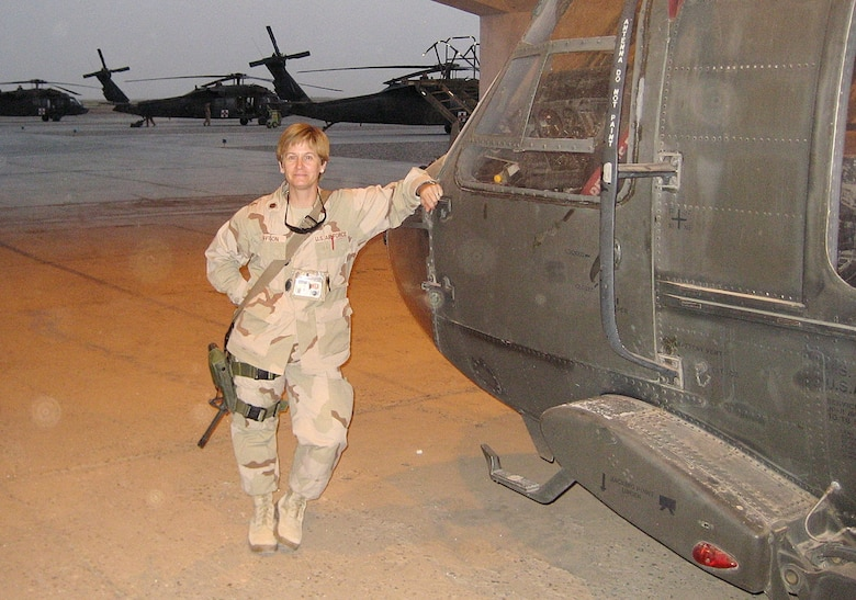 Major Lisa Davison, 14th Medical Operations Squadron, takes a break to pose with a chopper during her deployment in Iraq. Major Davison is a Mental Health Nurse at the Combat Stress Control Detachment 732nd Expeditionary Support Squadron in LSA Adder, Iraq. (U.S. Air Force Photo)