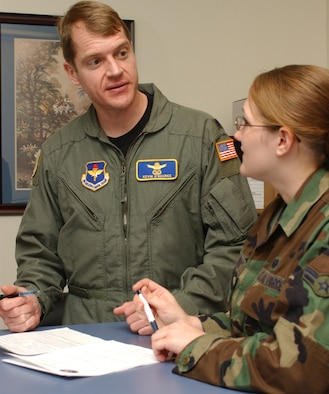 Lt. Col. Kevin O'Rourke, left, new commander of the 81st Training Support Squadron, goes over inprocessing procedures with Airman 1st Class Ashley Le Duc of his staff.  Colonel O'Rourke took command June 14 from Lt. Col. Dale King, who retired.  He earned a bachelor's degree in electrical engineering from Penn State and a master's degree in operations analysis from the Air Force Institute of Technology.  He comes to Keesler from the Pentagon, where he was congressional activities lead for the Strategic Security Directorate at Air Force headquarters. (U. S. Air Force photo by Kemberly Groue)