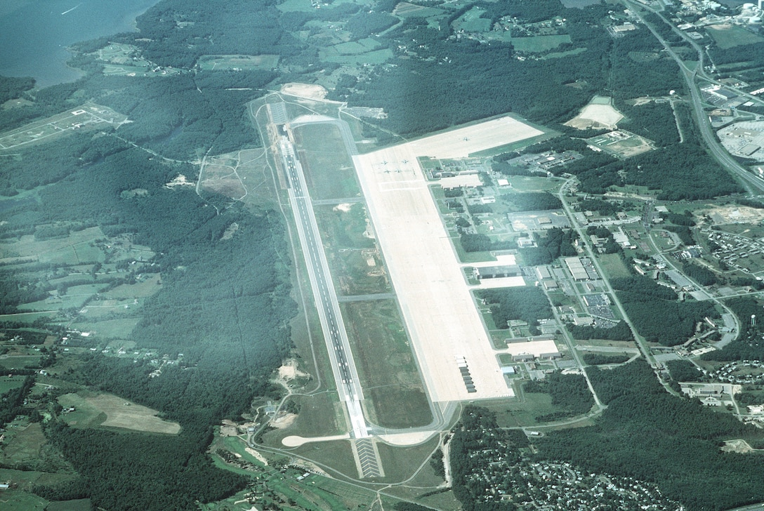 High oblique aerial view, looking north of Pease Air National Guard Base, formerly Pease Air Force Base, N.H. This joint use civil and military airfield is home to the 157th Air Refueling Group flying KC-135R Stratotankers for the New Hampshire Air National Guard.