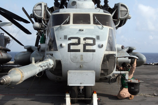 Captain Pete Lisowski, a CH-53E Super Stallion transport helicopter pilot with Marine Medium Helicopter Squadron 261, performs preflight operations checks on a Super Stallion during the 22nd Marine Expeditionary Unit's Certification Exercise aboard the USS Kearsarge, June 20, 2007. The Marines and sailors of HMM-261 are scheduled to deploy as the Aviation Combat Element of the 22nd MEU later this summer. (Official Marine Corps photo by Cpl. Peter R. Miller)::n::