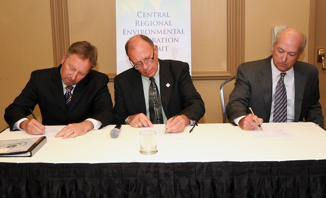 (Left to right) John Askew, U.S. Environmental Protection Agency Region 7, Doyle Childers, Director of Missouri Department of Natural Resources, and Robert Barrett, Air Combat Command Chief of the Asset Management Division of the Directorate of Installations and Mission Support, sign a Long-Term Stewardship Agreement for the Missouri Minuteman II Missile Sites, in Kansas City June 19. The agreement signifies the Air Force has satisfactorily completed required environmental steward actions in conjunction with the dismantling of the 165 missile silo and launch control facility sites active in the state throughout much of the Cold War. The Air Force will continue to monitor and inspect the sites to ensure compliance with restrictions placed upon landowners concerning use of the land. (U.S. Air Force photo/Tech. Sgt. Matt Summers)