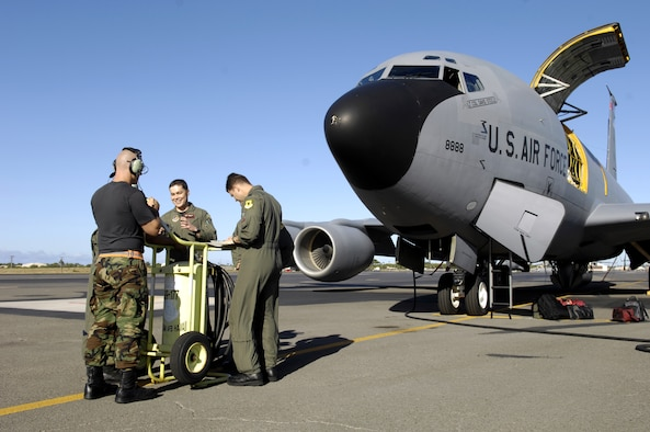 Aircrew and maintenance personnel prepare to launch for a refueling mission from Hickam Air Force Base, Hawaii June 18, 2007. A KC-135 Stratotanker from the 18th Wing, Kadena Air Base, Japan is at Hickam practicing with a C-17 Globemaster III from the 535th Airlift Squadron for the Air Mobility Command Rodeo. The Airmen are with the 909th Air Refueling Squadron. (U.S. Air Force photo/ Tech. Sgt. Shane A. Cuomo)