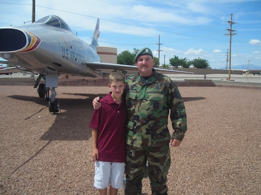 Twelve-year-old Alex Bood, pictured here with his father Master Sgt. Robert Bood, SERE superintendent for the 49th Operations Support Squadron, is getting the chance of a lifetime to travel as a student ambassador to Spain, France, Italy and Morocco. (U.S. Air Force photo/Airman 1st Class Heather Stanton)