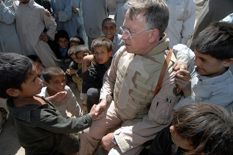 Children greet Lt. Gen. John Bradley June 17 in the village of Qal' ehye Yuzbashi in Afghanistan. General Bradley was delivering humanitarian supplies to the village located near Bagram Air Base. The supplies, destined for refugee camps, orphanages and hospitals throughout Southwest Asia, are part of the 9,000 pounds collected by General Bradley's wife, Mrs. Jan Bradley. General Bradley, chief of the Air Force Reserve and Air Force Reserve Command commander, is visiting Airmen throughout Southwest Asia to thank them for their service supporting the war on terrorism. (U.S. Air Force photo/Tech Sgt. Rick Sforza)
