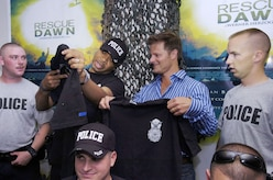 "Air Force Staff Sgt. Quentin Floyd from the 316th Security Forces Squadron Visitor Control Center presents actor Steve Zahn with a squadron T-Shirt to commemorate Zahn's visit to Andrews Air Force Base, Md. June 18, 2007. Zahn came to Andrews for a free prescreening of the new movie, ""Rescue Dawn."" (U.S. Air Force photo by Bobby Jones)"