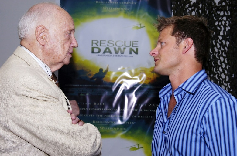 "Retired Air Force Col. Eugene Deatrick, left, who rescued Navy Lt. Dieter Dengler, a POW during the Vietnam War, chats with Steve Zahn, who plays Air Force 1st Lt. Duane Martin in ""Rescue Dawn,"" a new movie about Dengler's capture and escape. Deatrick and Zahn met during a June 18, 2007, premiere at Andrews Air Force Base, Md. (U.S. Air Force photo by Bobby Jones)"