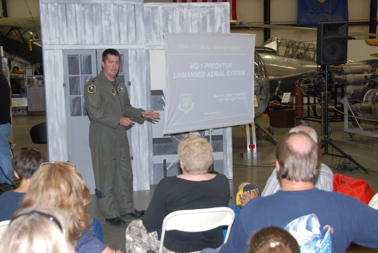 Maj. Eric Fagerland, a 163d Reconnaissance Wing Predator Pilot, conducts a mission briefing at the March Field Air Museum during an Open Aircraft Day this month. (U.S. Air Force photo by Staff Sgt. Eduardo Cervantes)