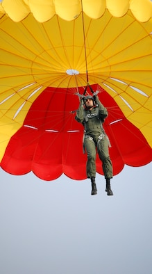 """LAUGHLIN AIR FORCE BASE, Texas – A student pilot with SUPT class 08-11 soars at about 300 feet during parachute training with Laughlin's Aerospace Physiology flight June 19.  Students """"fly"""" twice during the training; once at 300 feet where they are pulled by a truck the entire flight, and once when a technician in the truck releases them at around 600 feet and they free fall under the parachute.  (U.S. Air Force photo by Staff Sgt. Austin M. May)"""
