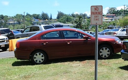 MARINE CORPS BASE CAMP H.M. SMITH, Hawaii - The recent demolition, construction and renovation projects of the headquarters building here has put a strain on near by parking spaces, so service members have begun parking illegally to avoid long walks up and down hills to work every morning.