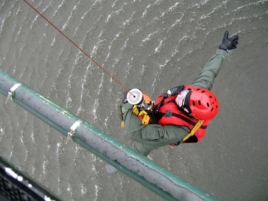 Staff Sgt. George Gonzalez practices water hoist procedures from a UH-1N Huey at Fairchild Air Force Base, Wash. Sergeant Gonzalez is an independent duty medical technician assigned to the 36th Rescue Flight as a flight medic in support of survival, evasion, resistance and escape specialist training and the Air Force combat survival school. (U.S. Air Force photo/Senior Airman Jacob Bragg)