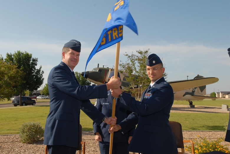 Col. D. Scott George, 17th Training Group commander, passes the 315th Training Squadron guidon to Lt. Col. Thomas Hensley during a change-of-command ceremony, which took place June 14 in front of the Norma Brown Building. Lt. Col Hensley replaced Lt. Col. Devin Swallow. (U.S. Air Force photo by Tech. Sgt. Gina O'Bryan)