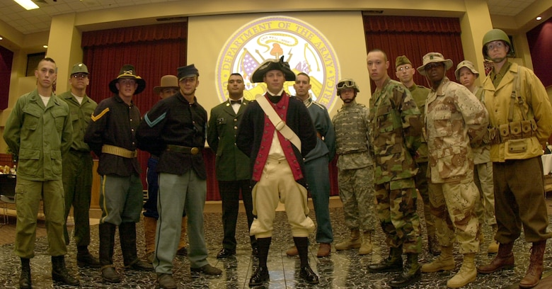 Fourteen student Soldiers from the 344th Military Intelligence Battalion showcased the rich, illustrious heritage of their service by wearing uniforms from different eras of the Army's history at the Army Ball Saturday at the C.J. Davidson Conference Center at Angelo State University. (U.S. Air Force photo by Airman 1st Class Luis Loza Gutierrez)