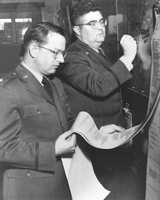 Tinker weathermen Maj. Ernest J. Fawbush, left, and Capt. Robert C. Miller forecasting tornado activity. (Air Force photo courtesy of Oklahoma City Air Logistics Center History Office)