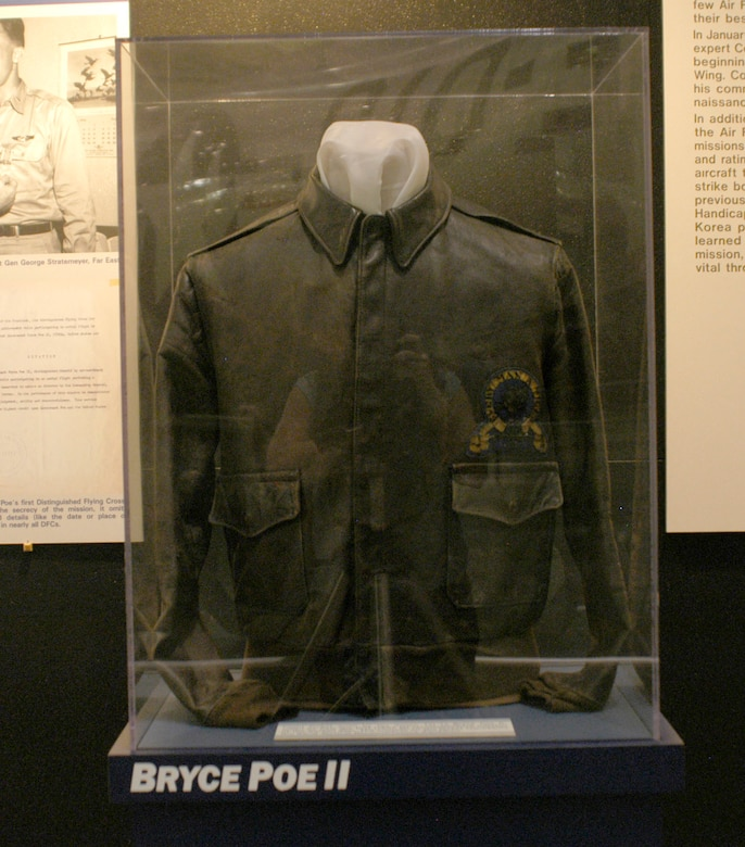 DAYTON, Ohio -- Flight jacket worn by the donor, 1st Lt. Bryce Poe II, when he flew the first U.S. Air Force jet reconnaissance mission of the Korean War. The insignia on the jacket represents the 82nd Tactical Reconnaissance Squadron. The jacket is on display in the Korean War Gallery at the National Museum of the U.S. Air Force. (U.S. Air Force photo)
