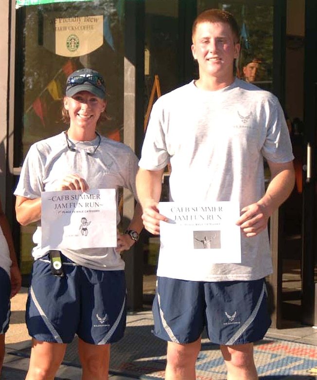 Captain Kristi Contardo, 14th Operations Support Squadron, was the first place female runner in the Summer Jam Fun Run Friday morning at the Fitness Center. Airman 1st Class Seth Skrypek, 14th OSS, was the first place male runner. (U.S. Air Force Photo by Airman 1st Class Danielle Powell)