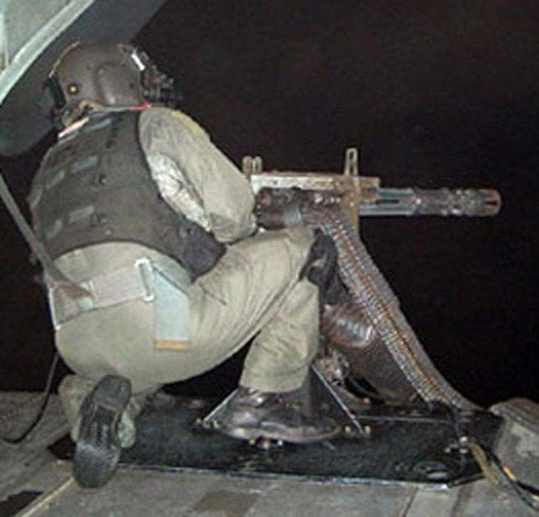 Master Sgt. Byron Allen, 1st Special Operations Group, works his 7.62 mini-gun from the back of an MH-53 PAVE LOW helicopter. Also one of the first six Airmen to receive the Air Force Combat Action Medal, Sergeant Allen was selected for the prestigious honor because of his heroics on a mission in Iraq in 2004. (Courtesy photo)