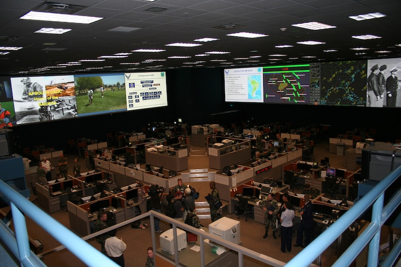 "A rare look inside the Gen. James H. Doolittle Combined Air and Space Operations Center facility at Davis-Monthan Air Force Base, Ariz. The facility is one of five ""Falconer"" CAOC weapons systems used to support geographic combatant commanders worldwide-- this designates an air operations center that is fully connected and capable of facilitating air; space and information operations worldwide. The other Falconer CAOCs are located in Southwest Asia, Europe, Korea and Hawaii. Each Air Operations Center has responsibility over a specified geographic location and mission."