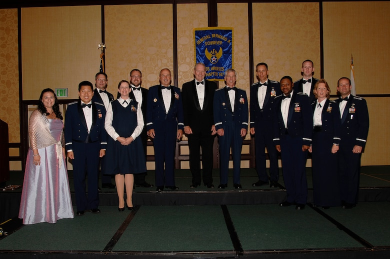 AFA's General Bernard A. Schreiver Chapter honored 147 outstanding SMC personnel at its annual Salute to SMC Banquet, June 22. Pictured from left to right are Stacy Dumas, Capt. Daniel Lim, Col. Randall Weidenheimer, Maj. Jennifer van Weezendonk, Brice Barrett, Lt. Gen. Michael Hamel, Retired Lt. Gen. Brian Arnold, Maj. Gen. William Shelton, Lt. Col. William Berkstresser, Capt. Donny White, 1st Lt. Alex White,  Lt. Col. Donna Shipton and Col. Wesley Ballenger. Other winners not pictured include: Capt. Donita Ruehs, TSgt. Travis Chenard, SrA Ashley Borja and Barbara Konieczny