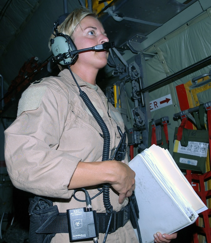 Capt. Michelle Mulberry, 455th Expeditionary Aeromedical Evacuation Flight nurse, speaks to the C-130 aircrew prior to receiving patients on an aeromedical evacuation mission from Bagram Airfield, Afghanistan. Capt. Mulberry is deployed from the Wyoming Air National Guard's 187th Aeromedical Evacuation Squadron, Cheyenne, Wyo. (photo by Staff Sgt. Craig Seals)