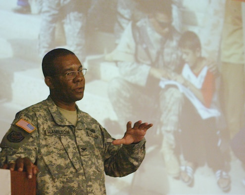 """Army Col. William Hamilton recently returned from Iraq, where he served alongside officers of the Iraqi army as an advisor to the Iraqi general who is in charge of security operations in Baghdad. Colonel Hamilton spoke at Dobbins Air Reserve Base to a group of local and base leaders as part of the Pentagon sponsored """"Share the Story"""" program meant to inform the public on progress in the rebuilding effort. """"It's not a case of going over there, blowing some people up and then leaving,"""" Colonel Hamilton said. """"The situation is a lot more complex than that."""" He gave specific examples and first-hand accounts of Iraqis risking their lives to begin rebuilding their country. Success will depend on them, he said."""