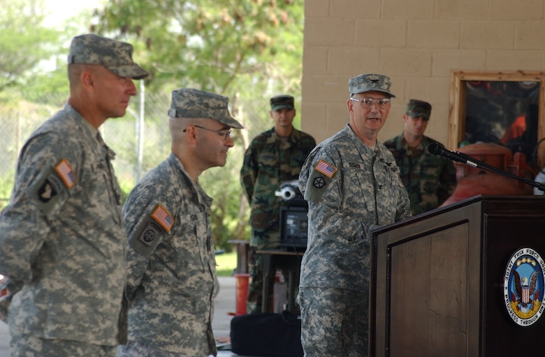 After taking command of the Joint Task Force-Bravo Medical Element here, Army Col. Michael Sigmon addressed those on hand June 25 at the Soto Cano Air Base Fire Department. Colonel Sigmond arrived from Fort Lewis where he served as a resident in preventive medicine. U.S. Air Force photo by Senior Airman Shaun Emery.
