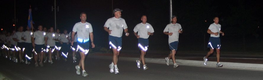 """WHITEMAN AIR FORCE BASE, Mo. - Members of the 509th Security Forces Squadron, Brig. Gen. Greg Biscone, 509th Bomb Wing commander and Chief Master Sgt. Brian Hornback, 509th Bomb Wing command chief, run in formation to the Spirit Gate to move the squadron's B-2 magnet on the Spirit Challenge Honor Roll board to the 12-month mark at 3:45 a.m. June 24. Despite having 70 percent of its work force under 24, the 509th SFS was officially DUI free for a year. """"This isn't about us, the leaders, it's about the Airmen taking care of each other and doing what is right,…being good wingmen"""" said Lt. Col. Craig Allton, 509th SFS commander. """"They really make me proud.""""  (U.S. Air Force photo/Airman 1st Class Stephen Linch)"""
