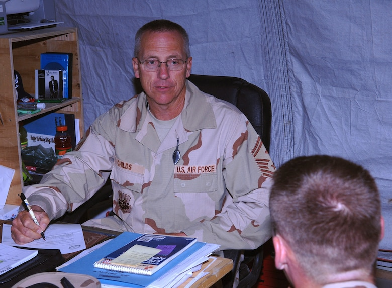 Senior Master Sgt. Ross Childs, 455th Expeditionary Mission Support Group first sergeant, mentors a young Airman in his office at Bagram Airfield, Afghanistan. Part of Sgt. Child's duties as a first sergeant include mentoring and assisting Airmen with any problems they might have. Sgt. Childs is deployed from the Utah Air National Guard's 67th Aerial Port Squadron. (photo by Staff Sgt. Craig Seals)