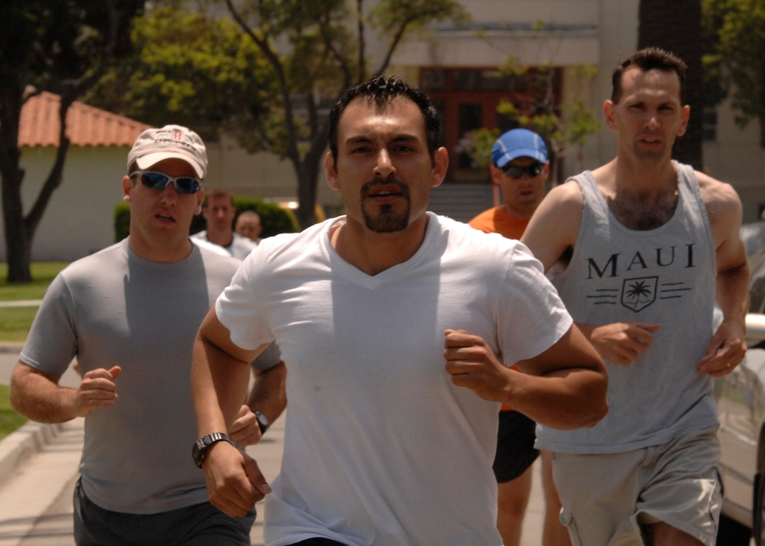 Lt. Michael Bowker, Tony Buenrostro and Lt. Gary Samson lead the pack during the 1 ½ mile run portion of the War Fit Challenge event at the 2007 SMC Sports Day, June 15. The Space Superiority Systems Wing took the day's overall title. (Photo by Joe Juarez)