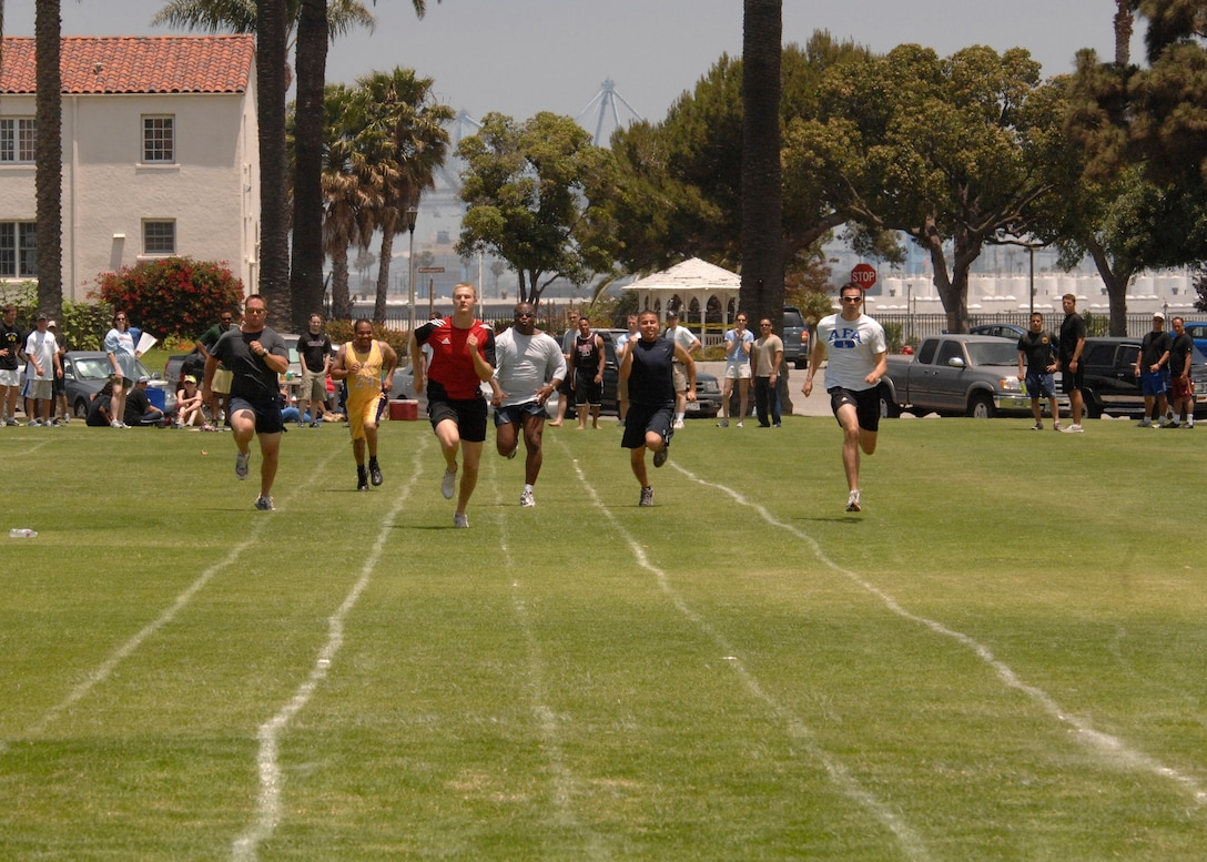 LAAFB Airmen run in the 100 yard dash at the 2007 SMC Sports Day, June 15. Lt. Curtis Engelson, wearing the red shirt, won this heat. The Space Superiority Systems Wing took the day's overall title. (Photo by Joe Juarez)