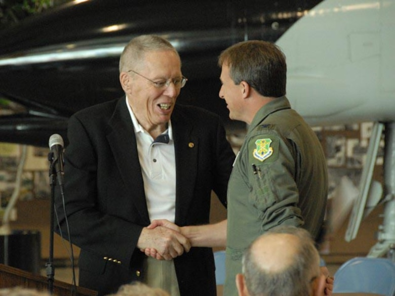 Retired Maj. Gen. Alexander P. McDonald, the former North Dakota adjutant general, shakes hands with Col. Robert J. Becklund, 119th Wing commander, as they discuss their actions during events that happened 20 years earlier.