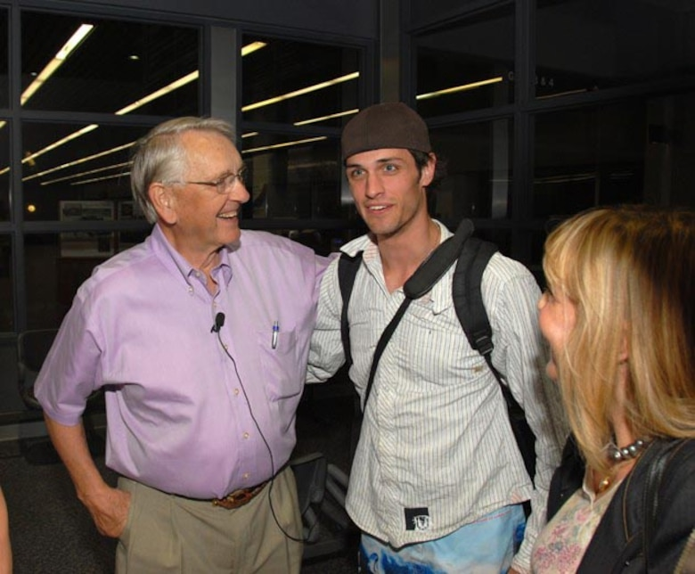 Former North Dakota governer George Sinner greets Andrew De La Pena at Hector International Airport May 13. Governer Sinner was instramental in the decision to use a North Dakota Air National Guard F-4 to transport Andre's new heart after a civilian jet which was originally designated to transport the heart had an engine failure.
