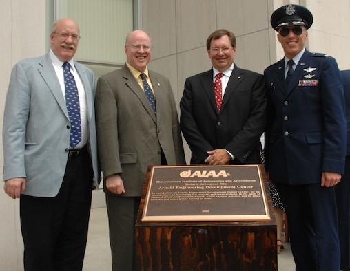 Pictured from left to right: Arnold Engineering Development Center (AEDC) Historian David Hiebert, Dr. Richard Hallion, former Air Force Historian, Steven Noneman, mission manager for the Lunar Crater Observation and Sensing Satellite at NASA's Marshall Space Flight Center, and AEDC Commander Col. Art Huber stand in front of the bronzed-plaque idenitfying AEDC as an American Institute of Aeronautics and Astronautics aerospace historic site. (Photo by David Housch)