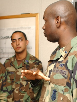 Cadet Orlando Sanchez, left, University of Puerto Rico, is briefed by 1st Lt. Schneider Rislin, 81st Security Forces Squadron, on the importance of the lifestyle and duties of force protectors during a tour of the squadron's command center.  (U. S. Air Force photo by Kemberly Groue)