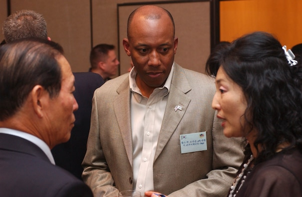 "KUNSAN AIR BASE, Republic of Korea -- Col. CQ ""Wolf"" Brown, 8th Fighter Wing commander, talks with Gunsan City Mayor, Moon, Dong Shin, and Rosemary Song, 8th FW Public Affairs Office Community Relations Chief at the officer's club June 22. Colonel Brown hosted a dinner for eight Gunsan City civic leaders, including Mayor Moon.  The dinner provided a chance for Kunsan Air Base to build relationships with host-nation civic leaders and partners from Gunsan City. (U.S. Air Force photo/Senior Airman Steven Doty)"