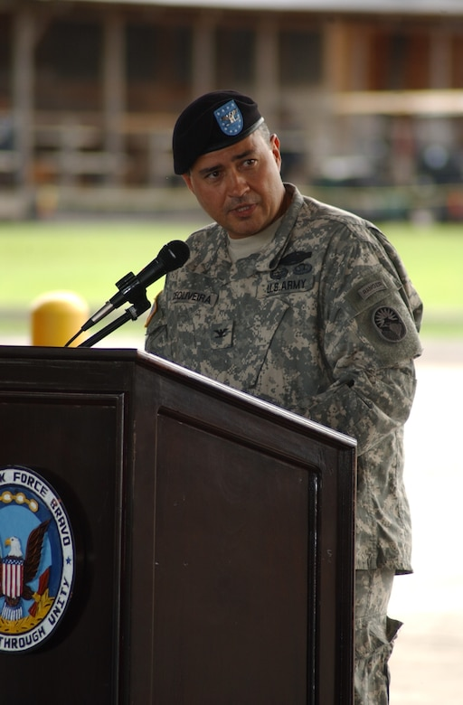 Army Col. Marcus DeOliveira, addresses members of Joint Task Force Bravo during the JTF-Bravo change of command ceremony at the Soto Cano Air Base Fire Station June 27. U.S. Air Force photo by Martin Chahin.