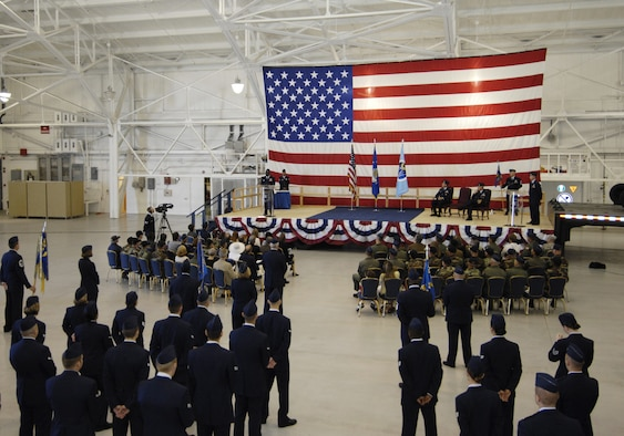 Col. Andre Lovett gives his first speech as the 30th Operations Group commander to more than 100 people during the change of command ceremony at the 76th Helicopter Squadron hangar June 22.  (U.S. Air Force photo/Airman 1st Class Johnathan Olds)